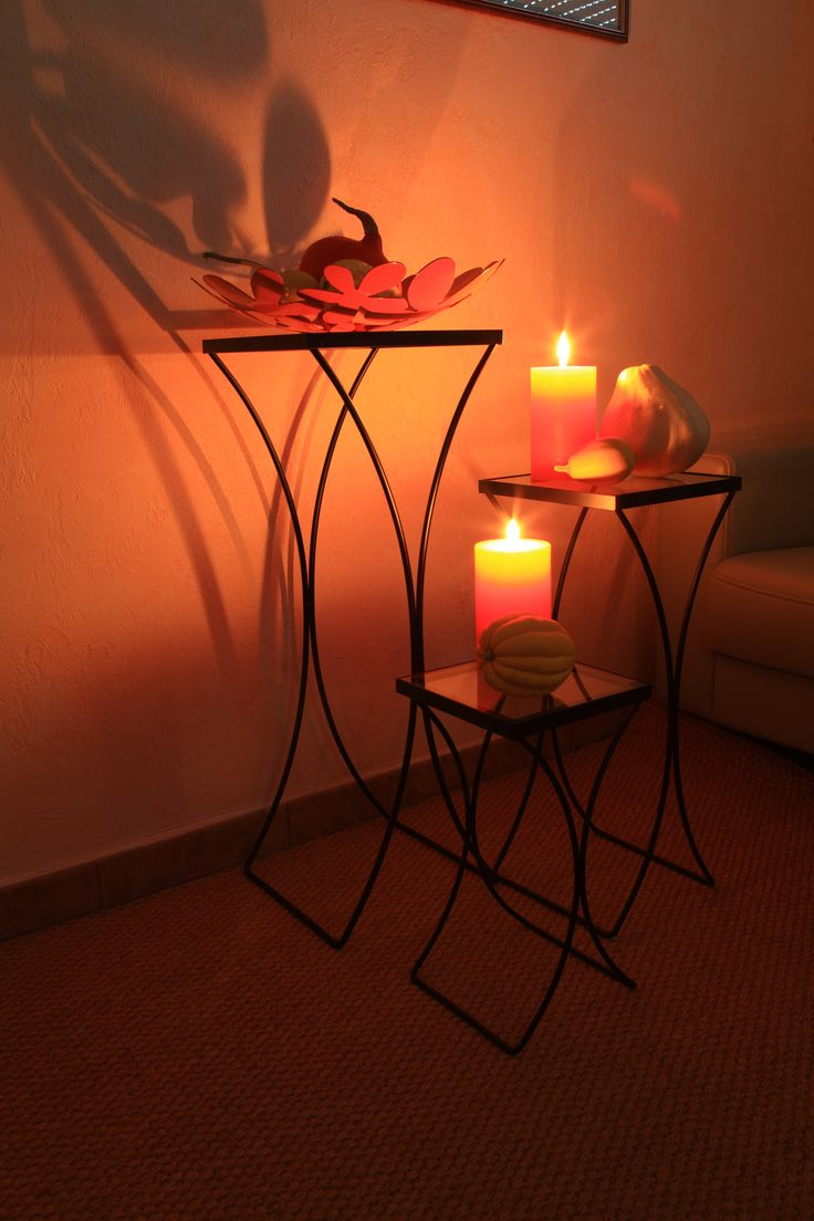 Candlelight composition with three size of metal table with wooden top