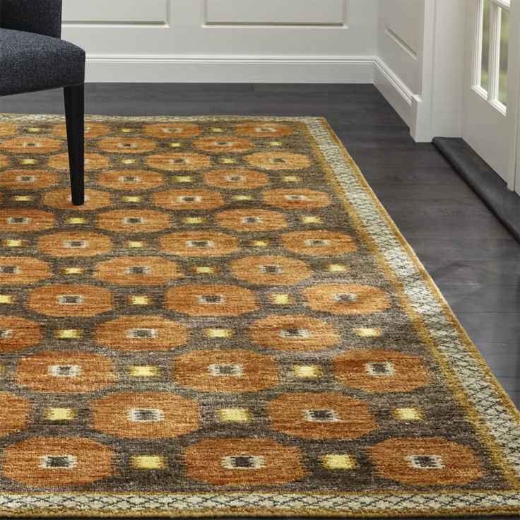 """Characteristic of the mid-century Scandinavian rugs that inspired Barbara Costas' design, the hand-knotted, wool-blend Alvy rug is a graphic take on traditional rug patterns, rendered in a high-contrast palette of warm autumnal hues.<br><br><a href=""""/special-features/patterned-rugs/1"""">Shop all patterned rugs</a><br><br><NEWTAG/><ul><li>Designed by Barbara Costas</li><li>52% wool and 48% rayon yarn</li><li>Rug pad recommended</li><li>Professional cleaning recommended</li><li>Shedding will…"""