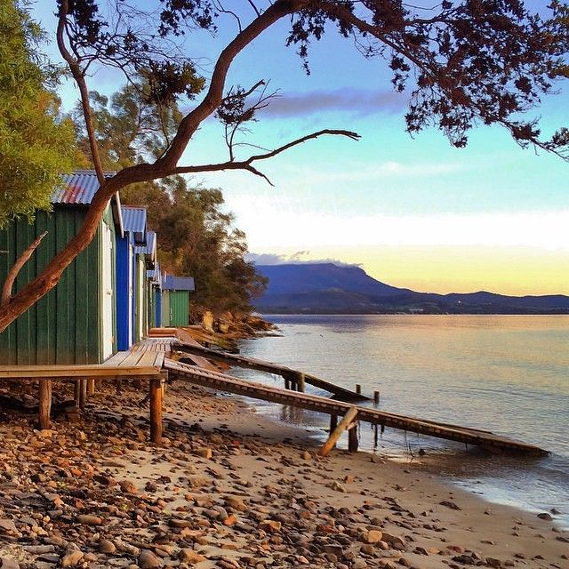 Sunrise serenity at Coningham Beach, south of Hobart. During Tasmania's long spring and summer days, the quaint boatsheds that line this family-friendly beach provide the perfect settings for outdoor relaxation with family, friends and fellow beach-goers. #beach #sunrise #hobart #tasmania #discovertasmania Image Credit: lifecatchme
