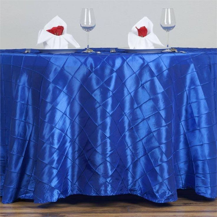 """Royal Blue Pintuck Tablecloths 120"""" Round - Pintuck is actually a fold of fabric that is stitched intricately to hold it in a place, very much like a pleat. These lovely pleats impart a decorative effect to the fabric by fashioning a visual line at a chosen point. They effortlessly bridge vintage and contemporary styles to create a majestic new classic look. If you do not want your celebration to blend in with other weddings, birthdays, and anniversaries, try our premium quality pintuck…"""
