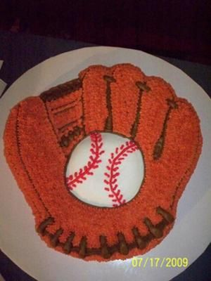 Baseball Glove Cake: I did this baseball glove cake for an auction and my husband loved it.  I used the baseball glove shaped pan I bought off ebay, and I used one cake mix.