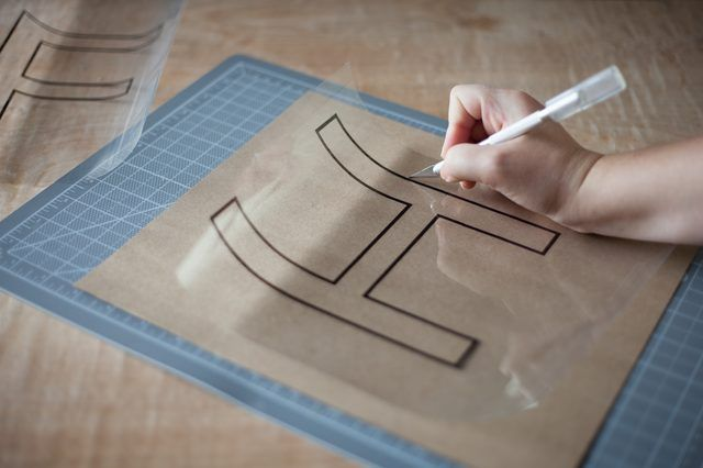 Stencils are useful for tracing letters with exact precision, especially large letters. Forming large letters free-hand is difficult because you lose control of the letter due to the large scale of it. You can buy large alphabet stencils in most craft stores, or you easily can make them yourself at home with a few rudimentary craft supplies and...