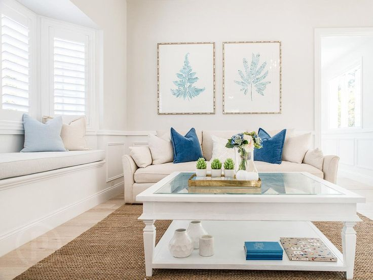 White Hamptons-style home in Queensland. Featuring blue Fern and Banana Palm fine art prints in Bamboo frames by artist Kerri Shipp of Driftwood Interiors.