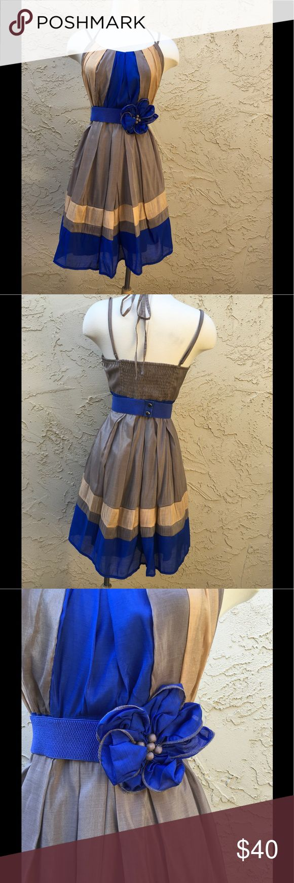 "🆕 Sleeveless Blue Tan Dress By Ryu Boutique 🌟🌟 Gorgeous Ryu Sleeveless New Dress. Adjustable Straps, Ties Back. Smocked Back For Good Support. Lightweight Fully Lined.Hidden Side Zipper. Elastic Belt With Center Fabric Rosette. 20% Cotton, 80% Polyester. Medium Measure, 16"" armpit to armpit, 14"" Waist, 27"" Length From Under armpit. Large Measure, 18"" armpit to armpit, 16"" waist, 28"" Length From under armpit.                               Color is Blue and Metallic Tan and Light Peach…"