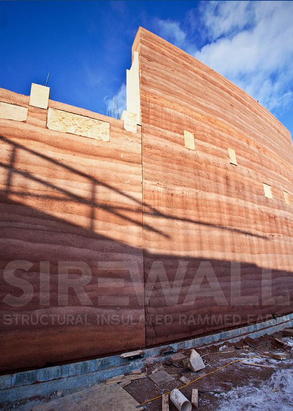 SIREWALL in progress at Brinton Museum Project. This would eventually become by far the tallest load-bearing modern rammed earth structure on the planet! Learn more at sirewall.com