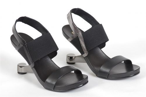 UNITED NUDE by Eamz Elan:  Uniquely United Nude. Enjoy the compliments and turn some heads with Eamz Elan sandal.  All leather upper with an elastic insep strap and a chrome 4 inch heel. Rubber non slip sole with an extra pair of heel lifts included.
