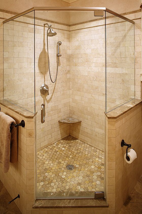 corner shower in master but with double shower heads and a rain shower head and different tile by gracie