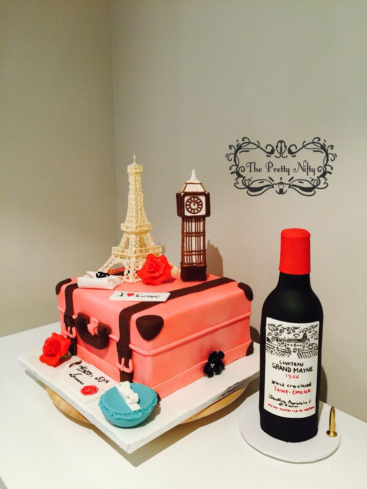 Suitcase Oreo cookies mud cake with milk chocolate ganache. Made for a lovely lady turning 50.   Eiffel Tower is made of piped white chocolate. Big Ben is made with white fondant and chocolate fondant glued with white chocolate. Wine bottle is made with white fondant then airbrushed with edible paint to achieve a black colour. It's label is drawn with edible pen. The rest of the decorations are completely edible.
