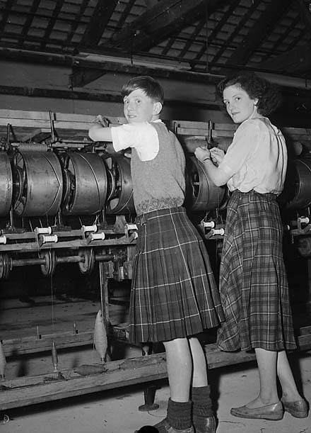 Models wearing a tartan skirt and kilt, Dinas Mawddwy Woollen Factory, 1 May 1952
