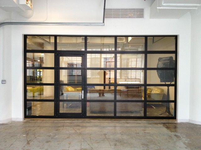 In Modern Buildings Full Vision Sectional Garage Doors Can Become A Perfect Substitution For Sliding W Glass Garage Door Garage Door Design Clear Garage Doors