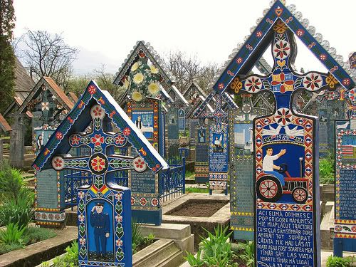 Merry Cemetery in Romania... So colourful and it appears that each stone tells a story of the person... very cool