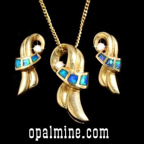 opal set inlays in 14k yellow gold. Matching pendant and earrings. Stunning scroll style- FREE SHIPPING