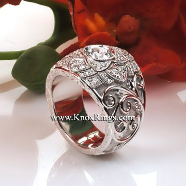 Design 3096 is an intricate tapestry of relief engraving, stippled background and bead-set diamond leaves