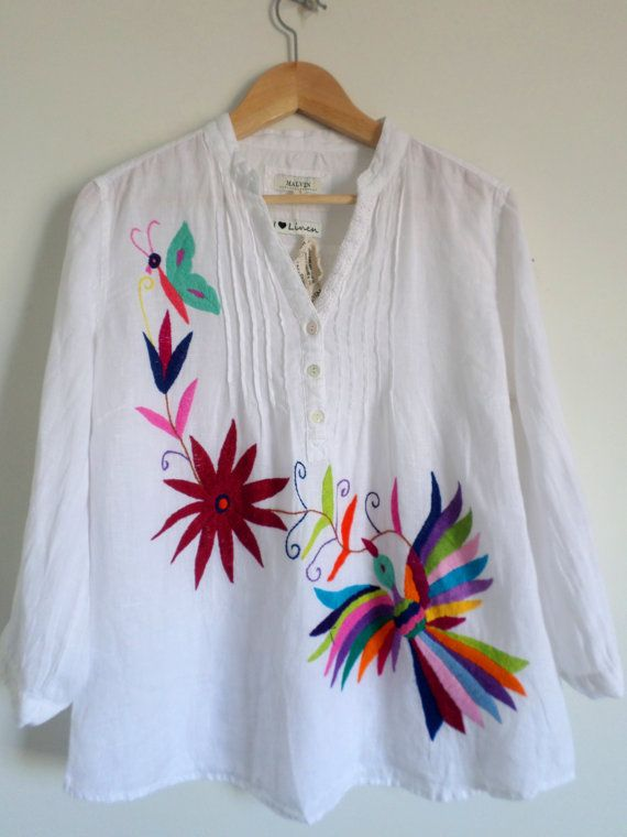 This beautiful hand embroidered blouse was embroidered in Tenango de Doria, Mexico. Available in size L only. 100% Linen. From German fashion house