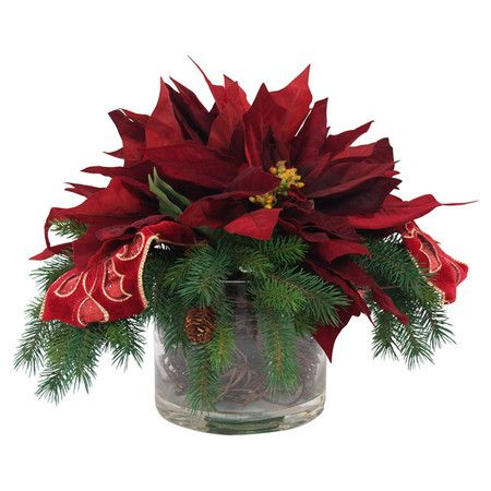 Faux poinsettia and evergreen arrangement with ribbon accents in a glass pot. Product: Faux floral arrangementConst...