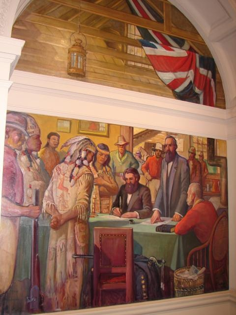 JUSTICE The establishment of the British style of justice as depicted of Chief Justice Matthew Baillie Begbie holding court at Clinton during the Cariboo gold rush. The aboriginal chief is shown standing before the judge suggesting the subjugation of natives to colonial law. — at B.C. Parliament Buildings.