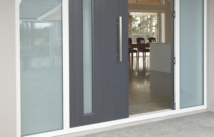 Double entrance doors with inset opaque glass and opaque sidelights.