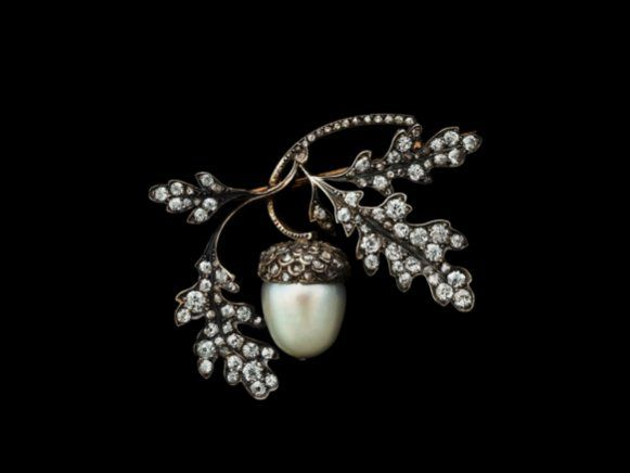 1880 Acorn Brooch of pearl, diamonds, gold, and silver by René Lalique, France.