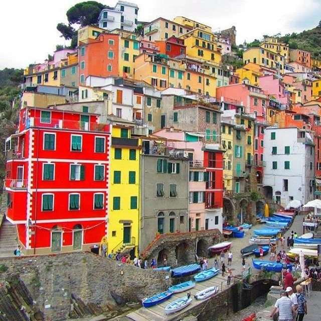 📸: Riomaggiore ➡️ The largest of the five villages and also known as the unofficial capital of the Cinque Terre. Make sure you head on down to the harbour where you can admire the  coloured architecture ❤️💛💚💙💜  www.thegirlswhowander.com  #thegirlswhowander #Riomaggiore #Italy #ItalianRiviera #topitalyphoto #hike #harbour #boat #beauty #travel #instatravel #photography #photooftheday #picoftheday #linkinbio