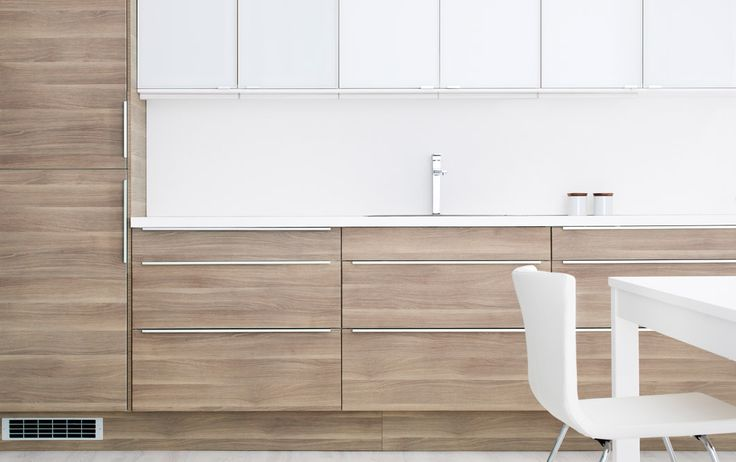 FAKTUM kitchen with SOFIELUND light grey walnut effect doors/drawers and RUBRIK white glass-doors