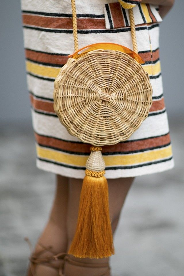 Straw sling bag and striped dress.