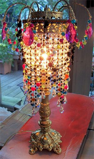 Lovely Boho-style lamp. And if done in a more subdued color palette or a single color ~ Steampunk!