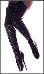 Lace Up  Thigh High Ballet Boots. Dress like a Mistress in these sexy thigh high ballet boots. They have a lace up front and an inner zipper for you convenience. Great for any fetish party. These lace up thigh high boots have a 7 inch heel and are available in either black leather or black patent leather.