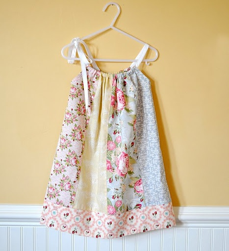 so, i actually don't really like patchwork, and kind of hate most floral patterns... and pastels... but this dress is ADORABLE!! so perfect for a little girl. love love love!