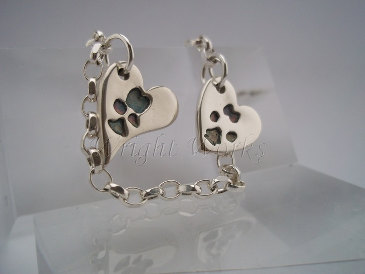 Paw print charms wavy heart design in fine silver with sterling silver bracelet