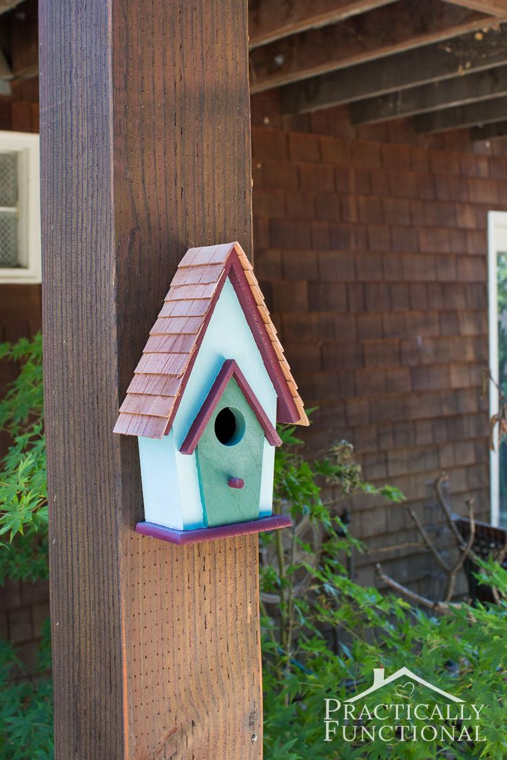 Here's a super cute backyard decorating idea for you: painted birdhouses!