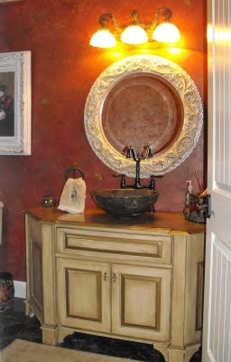 """Hand-textured plastered finish, Multi-Red Glazes, Raised """"Bumble Bee"""" stencil high-lighted in Bronze, Custom paint finish to bathroom vanity."""