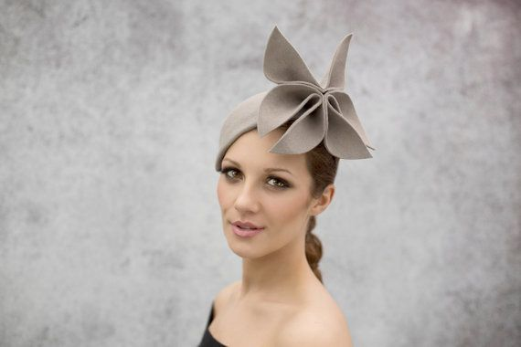 Elizabeth is a hand sculpted flower races hat. This womens fascinator hat is made from quality wool felt, hand formed to create this unique