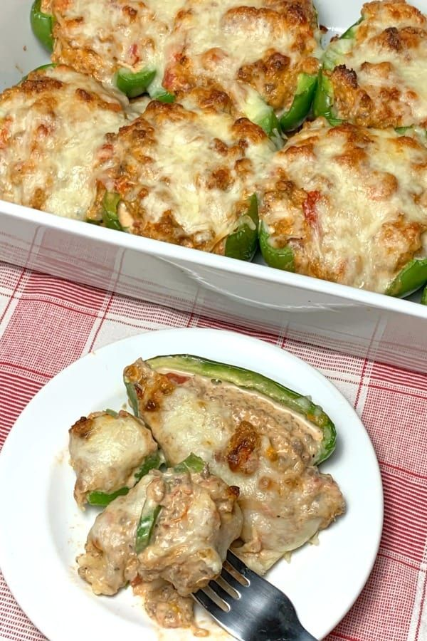 Oven Baked Keto Stuffed Green Peppers With Lots Of Cream Cheese In Bakign Dish And On A Plate With A Fork In 2020 Stuffed Peppers Easy Pasta Recipes Recipes