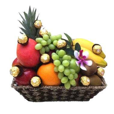Fruit Basket + Ferrero Chocolates + Free Delivery - made of natural seagrass and filled with seasonal fruits