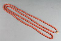 """Lot No 667 A string of 19th Century coral beads with a gold clasp 58"""", sold for £400"""