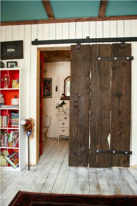 sliding barn door - for both a separation for the large upstairs bedroom and for the adjoining bathroom!!!!! LOOOVE!