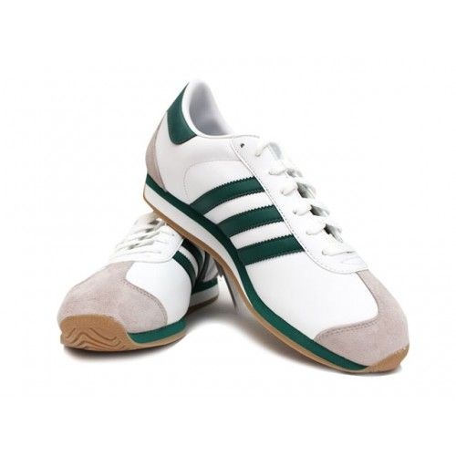 Adidas Country with Green Stripe.  The Adidas Country sneaker is similar to the original Adidas Country with the same unique toe & heel wrap, made with with a smooth leather-upper and a die-cut EVA midsole for extra cushioning. Perfect for the golf course, track or court.