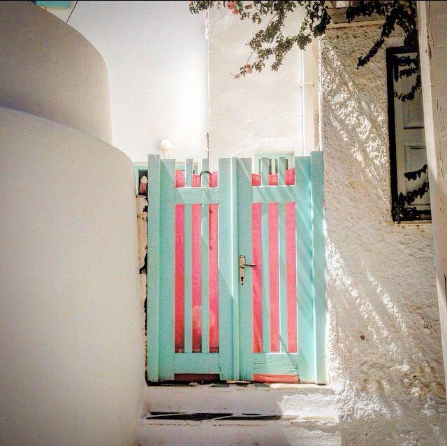 beautifull pale pink - blue door in Ios island, Greece