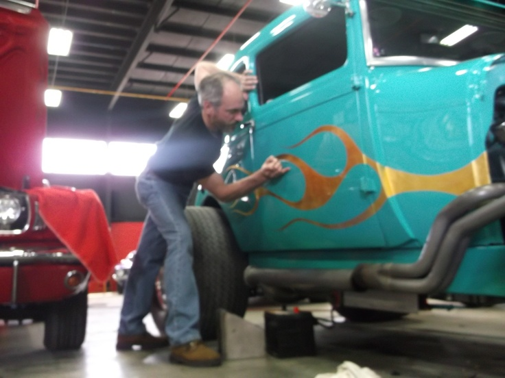 """Lil' Dickie"" outlining gold leaf flames with a pinstripe on a 29 Ford Coupe."