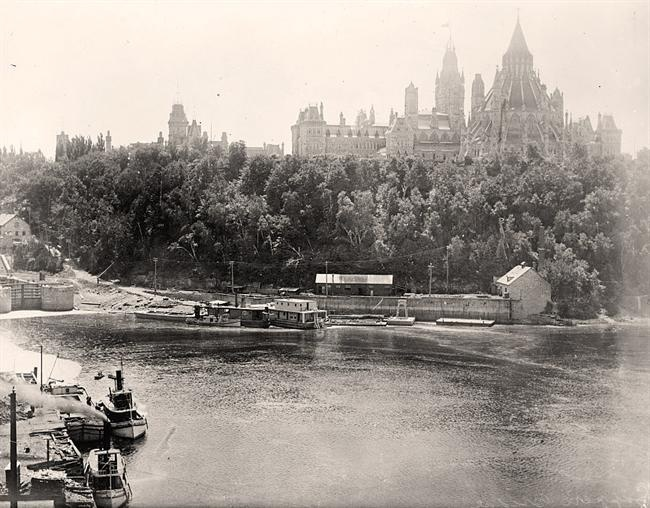 photograph of Canada, Dominion Of. Parliament Buildings and Lappers Bridge.  It was taken in 1914 by Harris & Ewing.