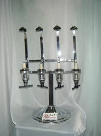 Liquor Dispenser. The liquor dispenser has room for 4 bottles & measures 1 once shots.