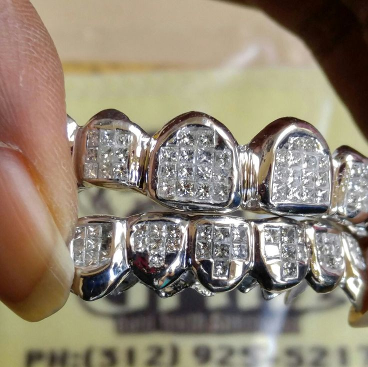 Top and Bottom Grillz princess cut ice cubes.. Iced out diamond grillz Custom fit gold teeth 6k - 22k gold silver or platinum  www.ChiGrillz.com