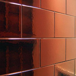 Mirrored Copper splashback in kitchen...
