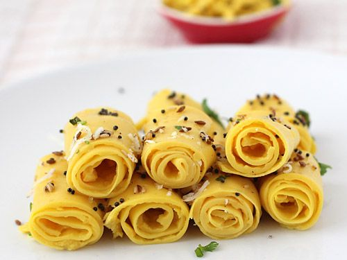 Khandvi - Popular Gujarati Snack - Soft and Mild Sour Gram Flour Rolls Tempered with Cumin Seeds, Mustard Seeds, Sesame Seeds and Curry Leaves - Step by Step Recipe