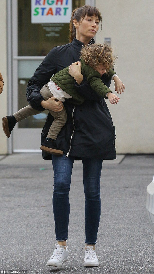 Hands on: Jessica was seen scooping the tot up into her arms and carrying him to the car as he wriggled about in her arms