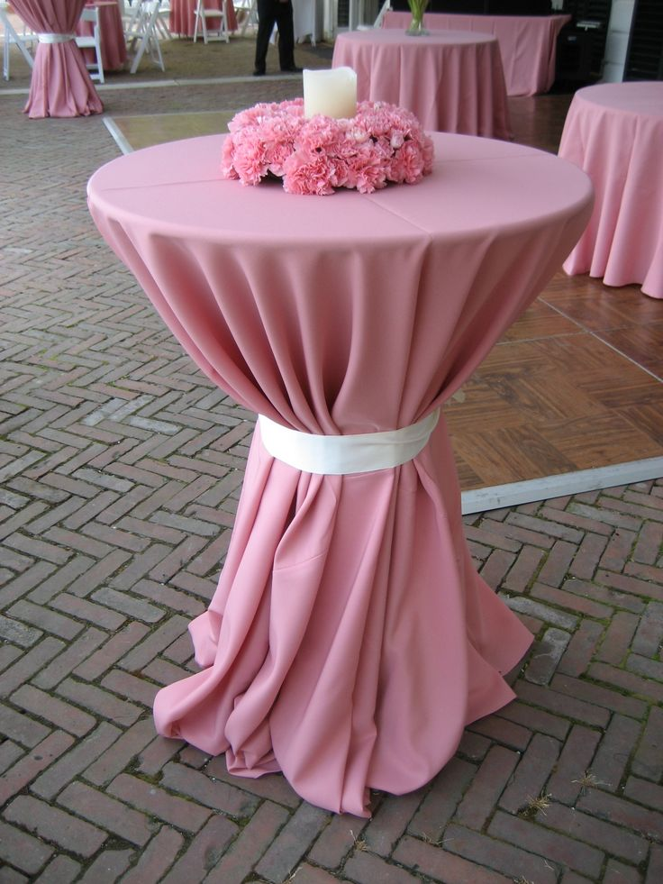 Cocktail Table centerpiece, a wreath of pink carnations with a led pillar candle.