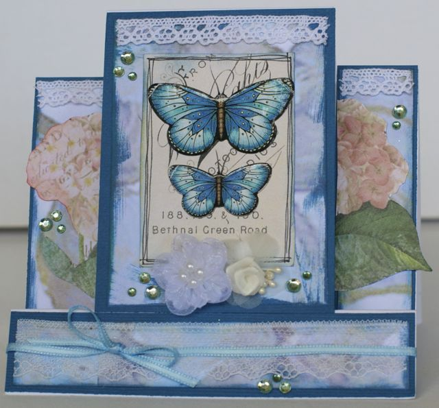A step card by Kelly-ann Oosterbeek made using the Watercolours In Blue…