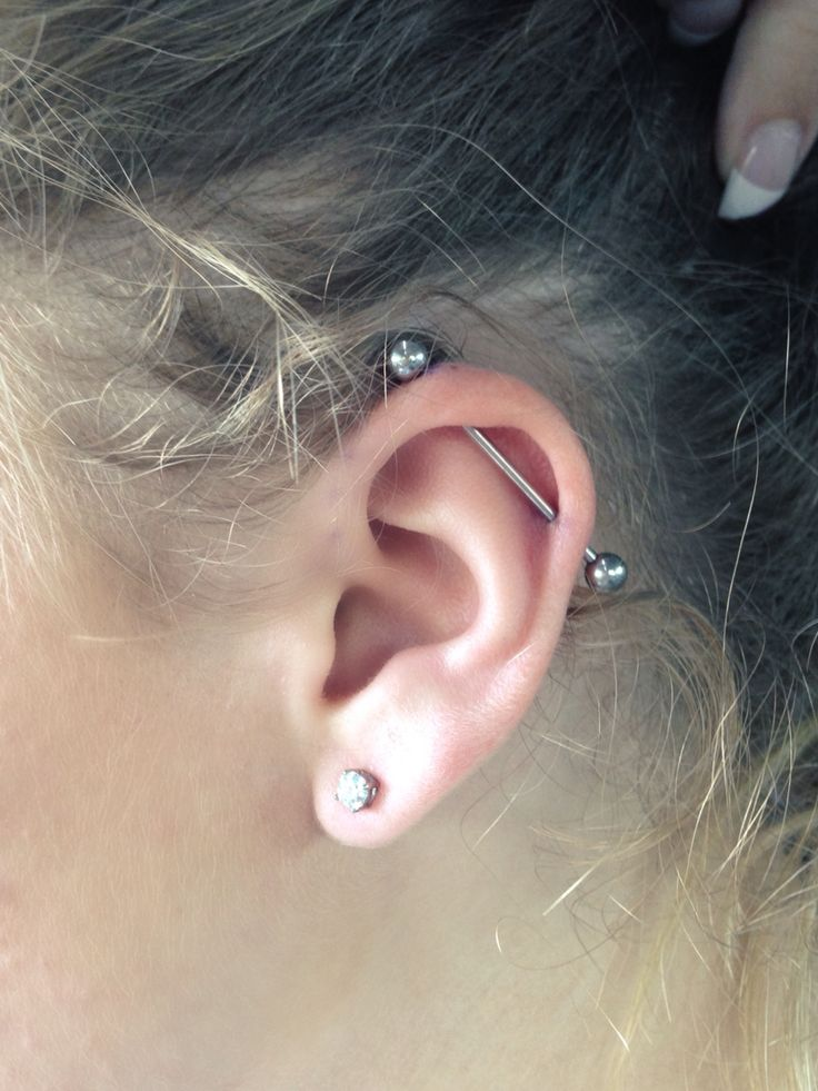 industrial bar ear piercing.