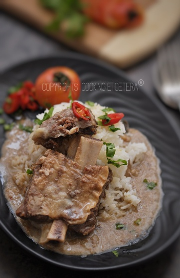 Nasi Gandul, is a special Indonesian food from center of java, its a ribs stew served in the top of warm white rice.