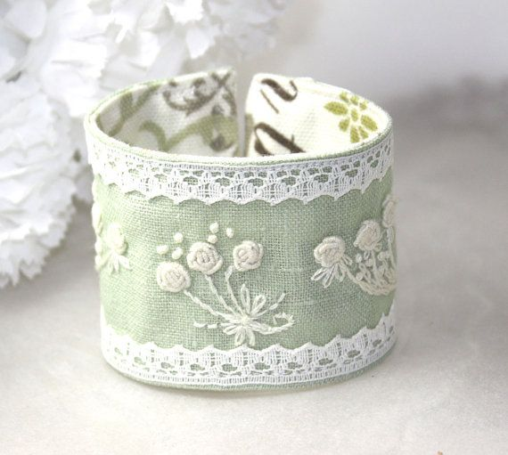 I think I can make this for less than $72.  Hand Embroidery Mint Rose Bouquet Embroidery Cuff by Waterrose.